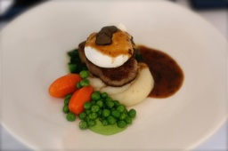 Filet of Beef, Perigueux Sauce, Pommes Puree, peas and carrots