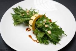 Delicata squash ring and mizuna with maple vin.